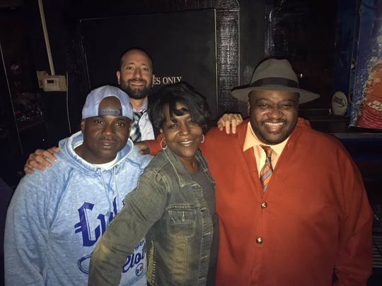 Elisa Grubbs (front row) attended an event at Mr. Mapp's Lounge in Detroit with City Councilman Gabe Leland (back row) in July 2017, one month before prosecutors say she delivered a bribe.