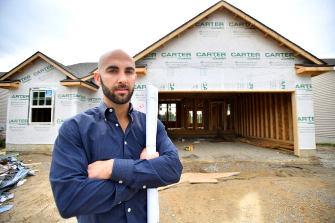 Home Builder Vito Castellana in one of the detached condominiums his company is building in the Cross Creek development in Burton, Mi, on Oct 3, 2018.  Michigan home builders are facing a shortage of sub contractors and higher construction costs.