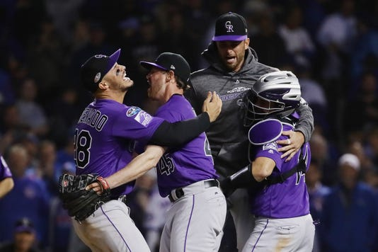 colorado rockies top chicago cubs 2 1 in 13 innings in epic wild