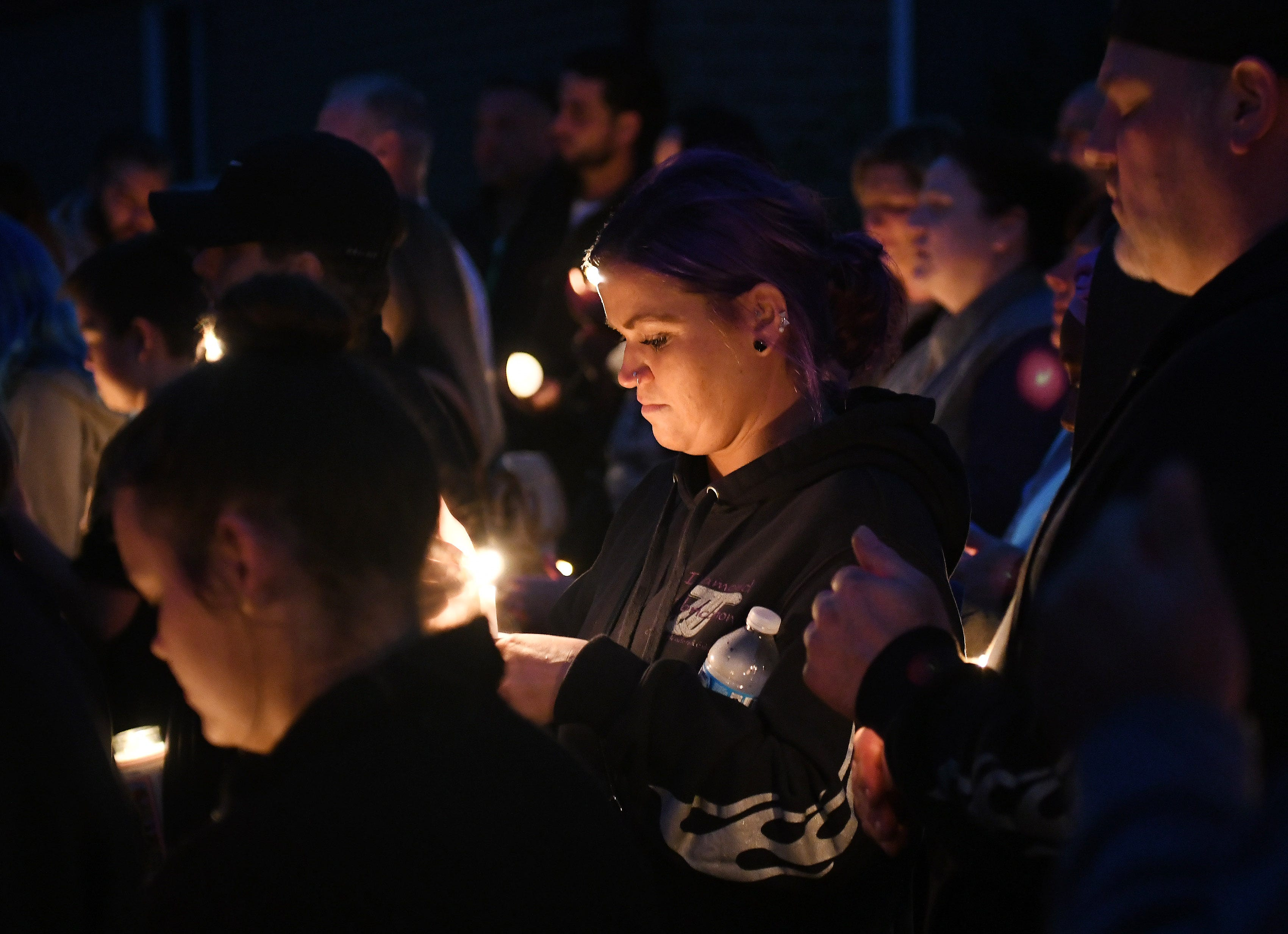 """Those gathered for the vigil called for support for the sole survivor, Mia Radosavac.  Joey Zago, a longtime family friend and godfather to the girls, noted the """"random acts of kindness"""" since the fatal fire."""