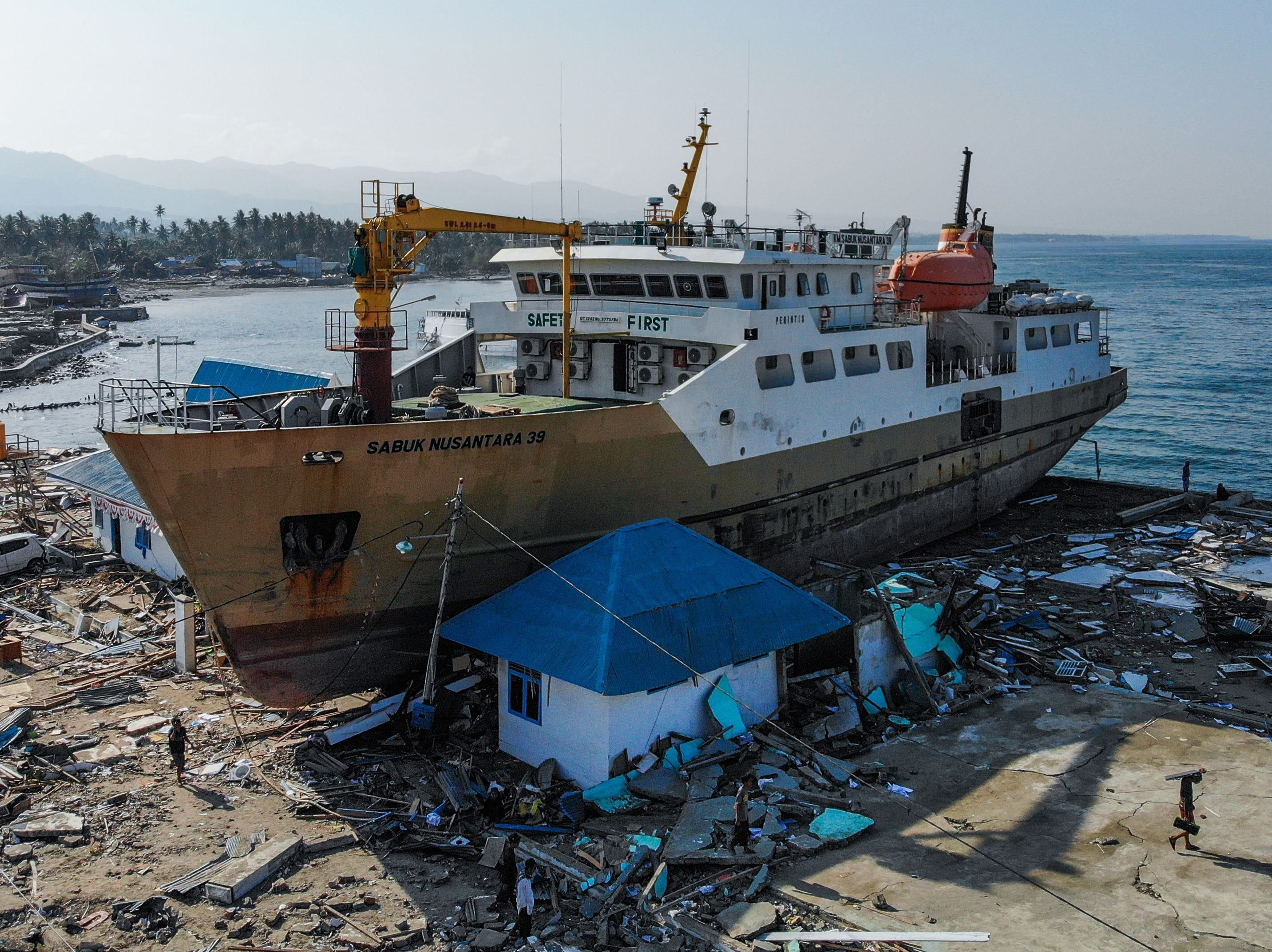A  passenger ferry  washed ashore into buildings in Wani, Central Sulawesi, Indonesia, after an earthquake and tsunami hit the area on September 28.