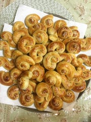 Kaak bi ajwa, or Palestinian date cakes, are hand-filled with a sweet date paste and hand-rolled.