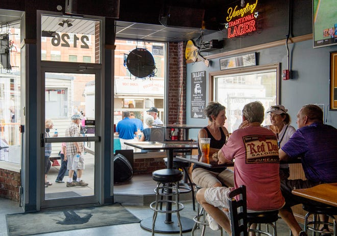 Most businesses close their doors when the West Side Nut Club's Fall Festival comes around, but the Franklin Street Tavern at 2126 W. Franklin Street offers air-conditioning and liquid refreshment to visitors of the popular festival Wednesday afternoon.
