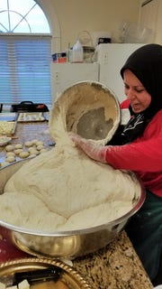 Fatima Hamaida prepares soft yeast dough for making fatayer.