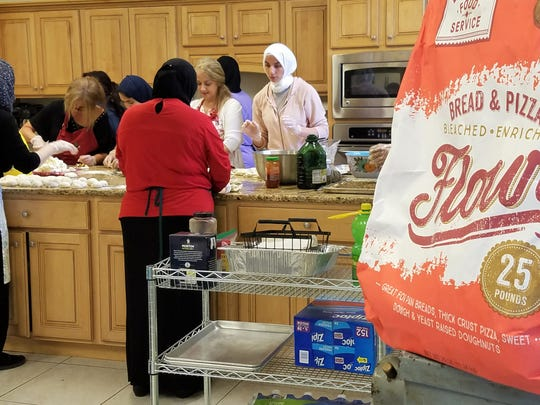 Women from Muslim countries around the world converge on the Islamic Center of Evansville's kitchen to prepare for the annual International Food Festival.