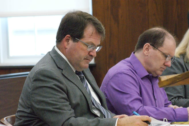 Daniel Myers, right, and his attorney Merle Dech at a hearing in October. Myers' murder trial has been rescheduled for March 4.