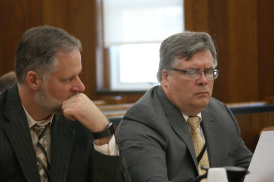 Sandusky County Prosecutor Tim Braun, right, reviews a juror's application with assistant prosecutor Ken Walz, left, Wednesday during a jury excuse hearing in the Daniel Myers homicide trial.