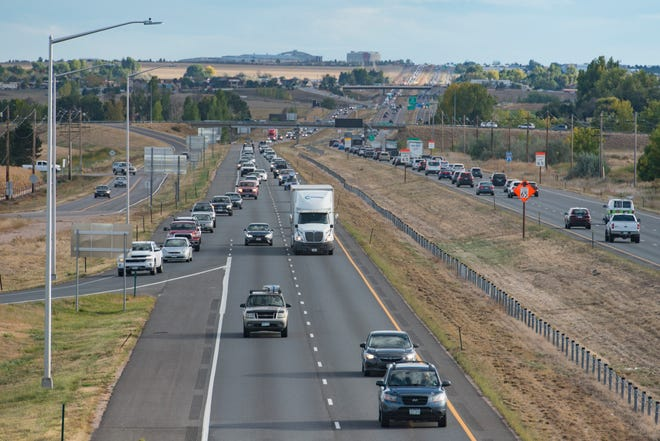 Traffic travels on I-25 near the Harmony Road interchange as evening congestion starts to pick up on Tuesday, October 3, 2018.  The interchange is considered a gateway to Fort Collins. The city is revising its development guidelines for the site west of the interstate.