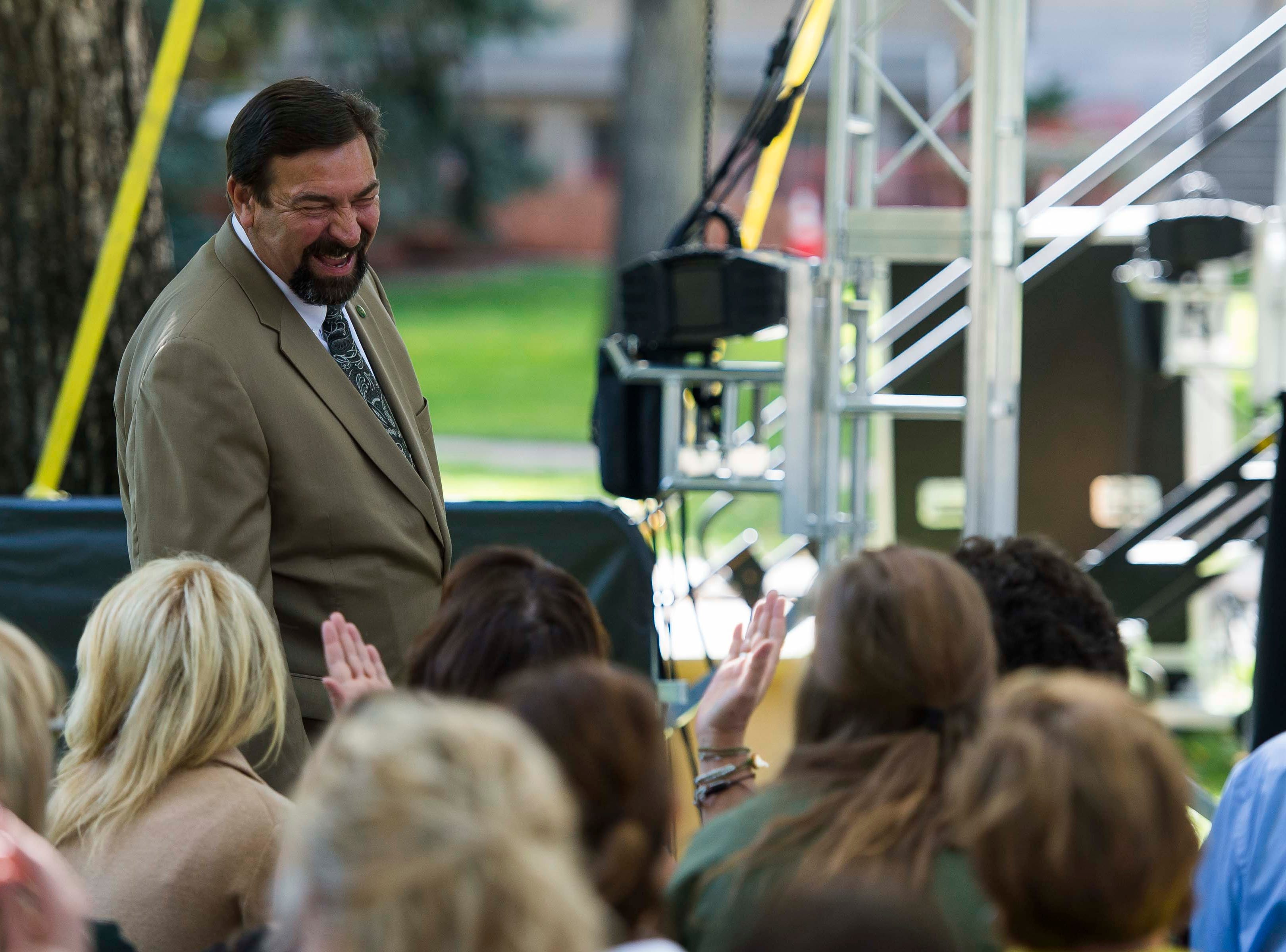 Colorado State University President Tony Frank chats with people in the front row before speaking to an audience on Wednesday, Oct. 3, 2018, at the 2018 fall address on the CSU campus in Fort Collins, Colo.