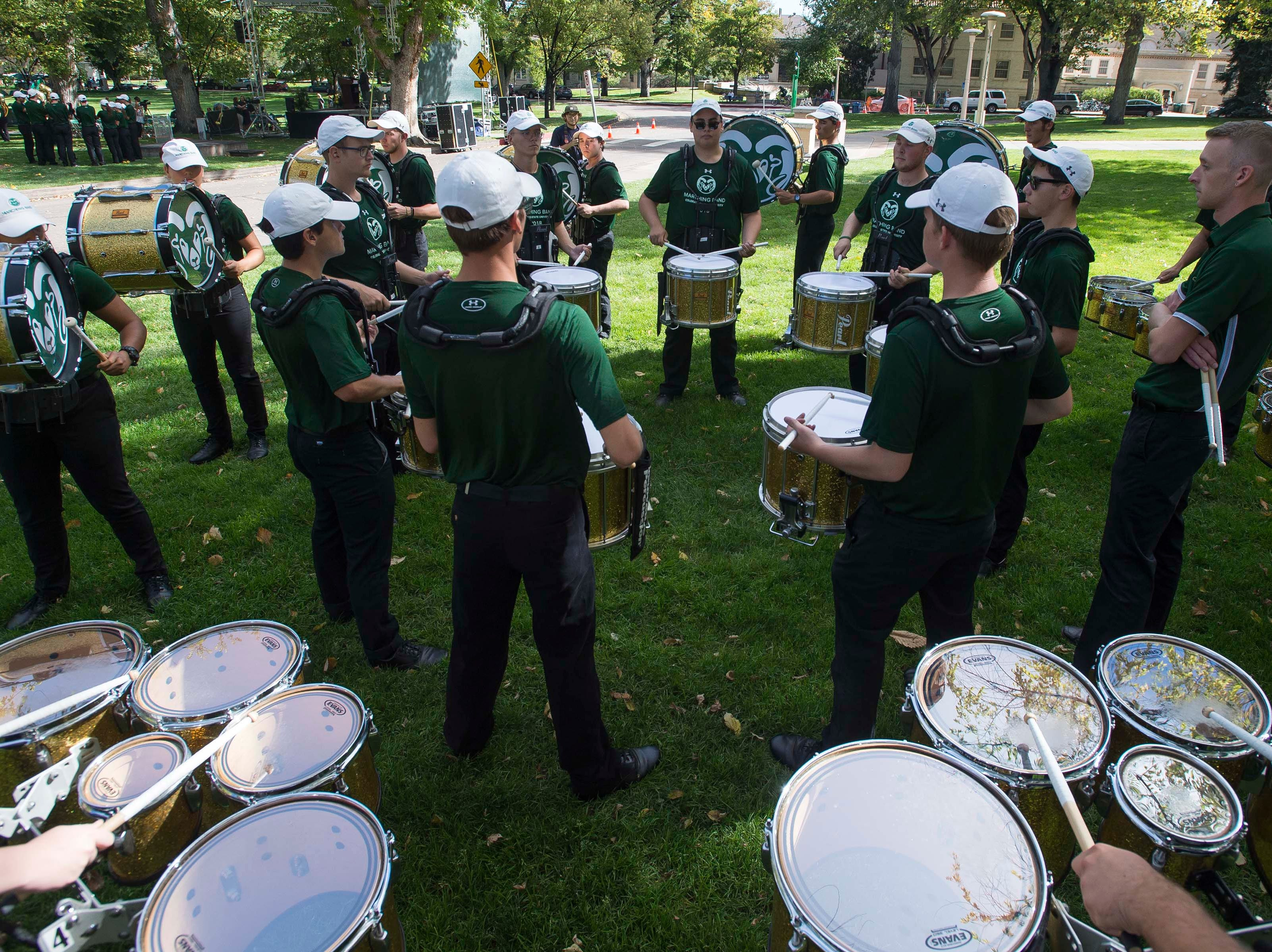 CSU marching ban d drummers practice before the 2018 fall address on Wednesday, Oct. 3, 2018, at the Colorado State University campus in Fort Collins, Colo.