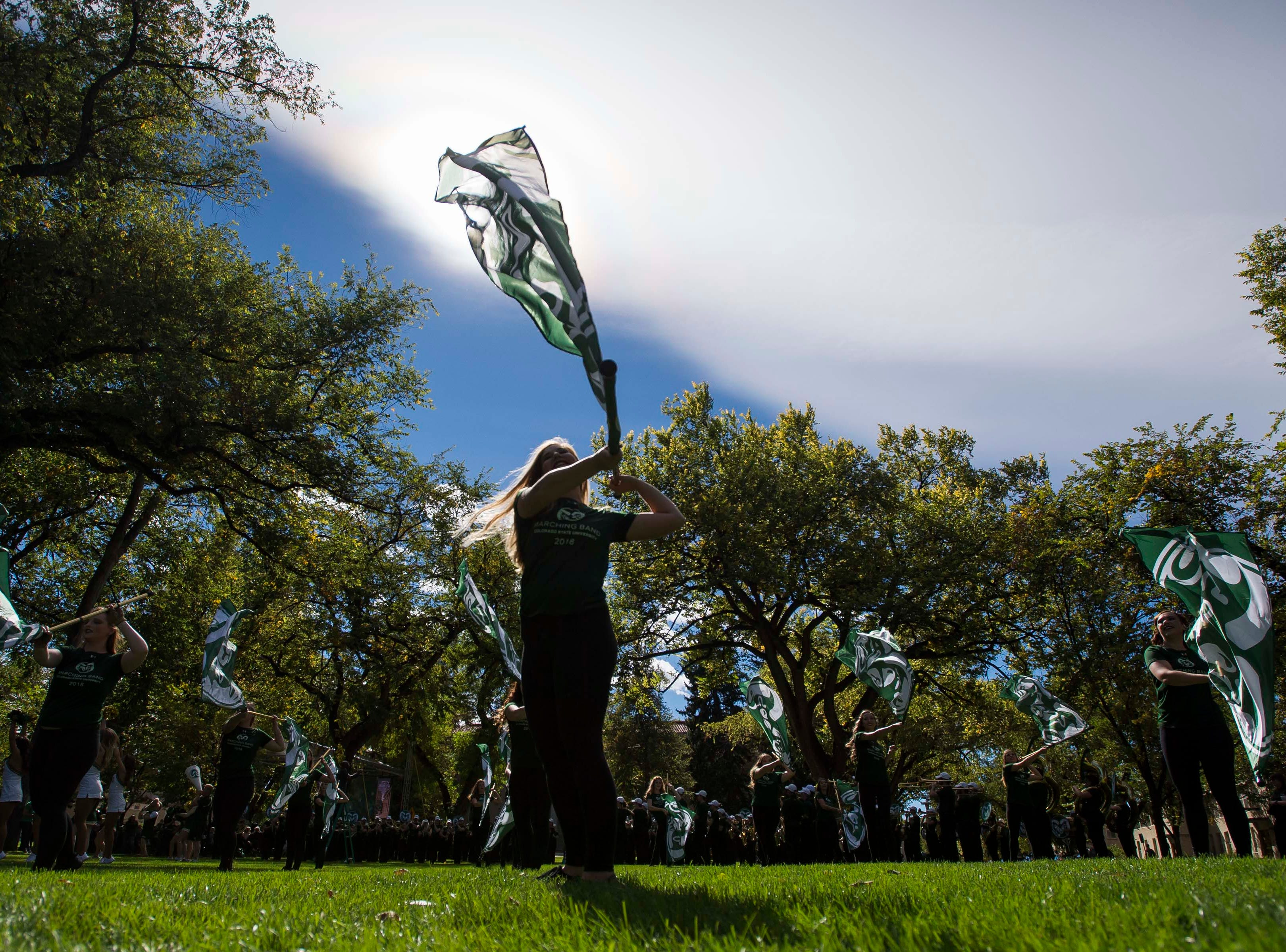 CSU marching band senior color guard Brittany Oelschlagger participates in the 2018 fall address on Wednesday, Oct. 3, 2018, at the Colorado State University campus in Fort Collins, Colo.