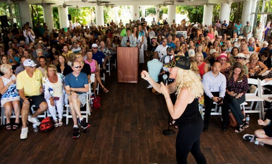 Environmental activist Erin Brockovich, center right, speaks at the Burroughs Home in downtown Fort Myers on Wednesday, Oct. 3, 2018. She was speaking on water quality issues.