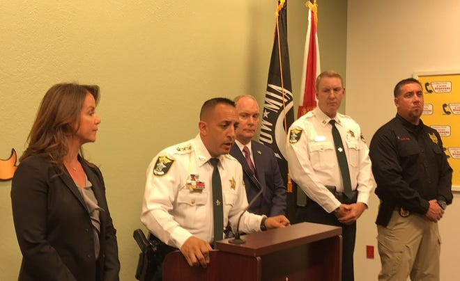 Lee County Sheriff Carmine Marceno talks about Operation Fall Frenzy, conducted by Sheriff's Office over the past two months, which culminated recently in 32 one-day drug-related arrests. At left is Florida state Sen. Lizbeth Benacquisto.