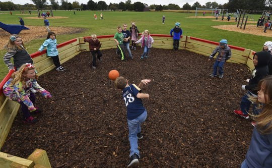 Second grade student Bryan Krueger hits the ball with his hand inside a Gaga Pit on the playground at Southern Door School on Tuesday, Oct, 2, 2018. Gaga ball is growing in popularity in the county.
