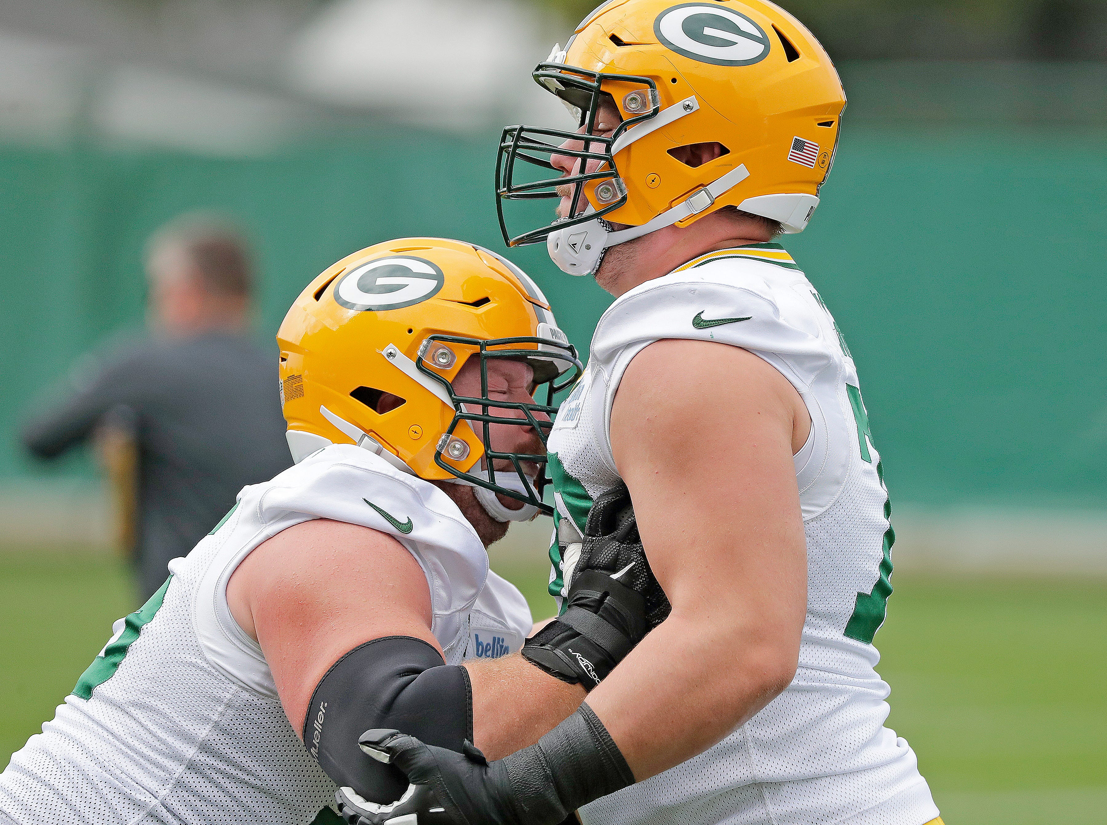 Green Bay Packers offensive tackle Bryan Bulaga (75) drills with offensive guard Alex Light (70) during practice Wednesday, October 3, 2018 at Clarke Hinkle Field in Ashwaubenon, Wis.