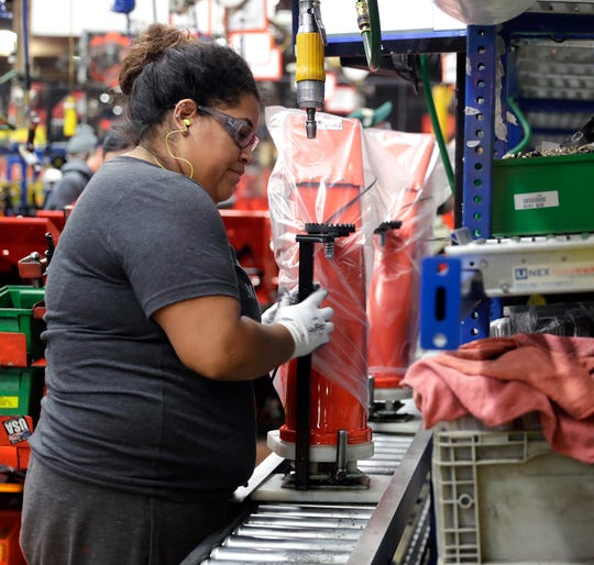 Ariens Co. employee Mariana Nieves works on the Sno-Thro assembly line Monday in Brillion.