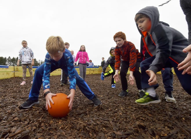 Fourth grade student Troy Geisel quickly shoots the ball between his legs to catch players off guard inside the Gaga Pit at Southern Door School on Tuesday, Oct. 2, 2018. The ball cannot hit an opponent above the knee.