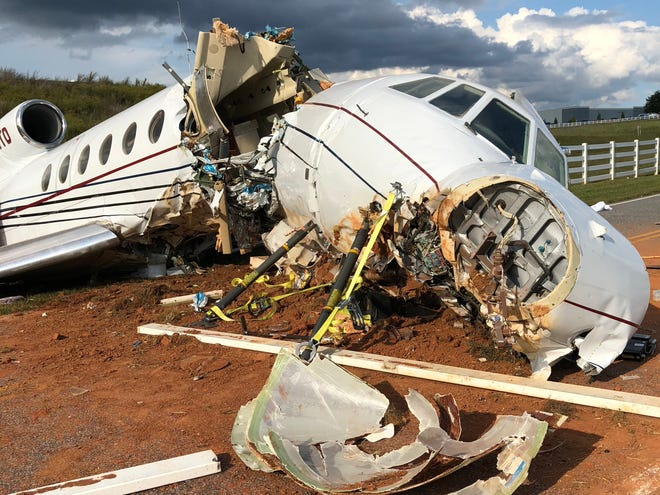 An airplane crashed off the runway at the Greenville Downtown Airport Thursday, killing a pilot and co-pilot and injuring two passengers.