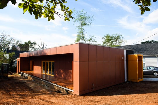 Konrad Lentschig said people often mistake his passive home for an office building when they go by.