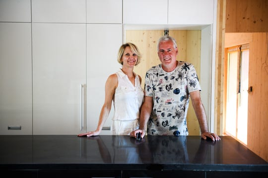 Cynthia Waddell and Konrad Lentschig stand in the kitchen of their home. The prefabricated building is being assembled according to passive design principles, which emphasize maximum energy efficiency.