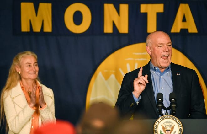 U.S. Rep. Greg Gianforte speaks, as his wife, Susan, stands next to him ahead of an appearance and speech by Vice President Mike Pence at a rally, Tuesday, Oct. 2, 2018, at the Gallatin County Fairgrounds, in Bozeman, Mont. Gianforte, who ran for governor in 2016, said he is considering a gubernatorial run in 2020.