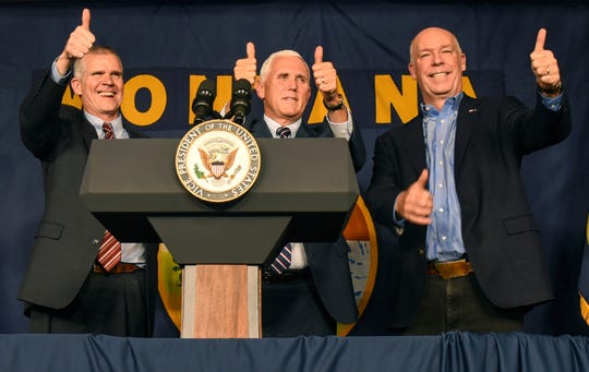 Montana auditor and U.S. Senate candidate Matt Rosendale, from left, Vice President Mike Pence and U.S. Rep. Greg Gianforte pose for a photo together after a rally, Tuesday, Oct. 2, 2018, at the Gallatin County Fairgrounds, in Bozeman, Mont. (Rachel Leathe/Bozeman Daily Chronicle via AP)