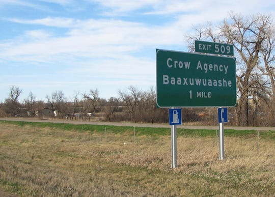 This April 10, 2006 file photo shows a sign along Interstate 90 on the Crow Indian reservation near Crow Agency with the tribal word for the community.