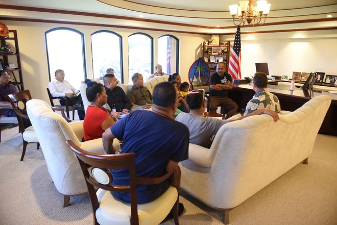 Acting Gov. Ray Tenorio, left, meets with two homeless families, along with officials from Guam Housing Corporation, Guam Housing and Urban Renewal Authority and other government agencies, at Adelup on Wednesday, Oct. 3, 2018. The families were among the last remaining shelter-seekers at the Astumbo gym in Dededo after Typhoon Mangkhut destroyed their homes.