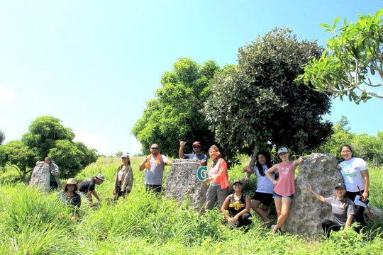 Students and cultural practitioners visit the Duge Latte Site in Rota, as part of a University of Guam course on latte stone carving and quarrying.