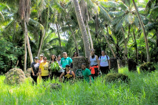 Students and cultural practitioners visit the Mochong Latte Village in Rota, as part of a University of Guam course on latte stone carving and quarrying.