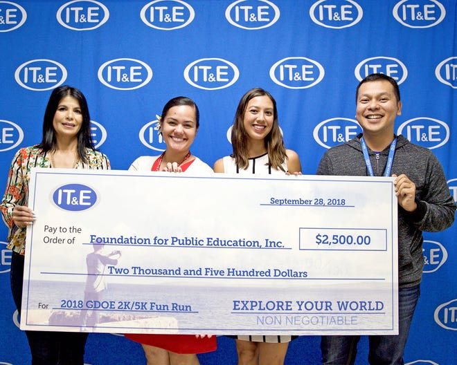 IT&E gives support to the Foundation for publication education by presenting a $2,500 donation for the GDOE 2K/5K Fun Run held Sept. 29.
