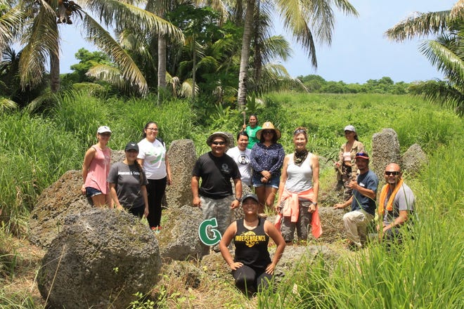 Students and cultural practitioners visit the Gempapa Latte Site in Rota, as part of a University of Guam course on latte stone carving and quarrying.