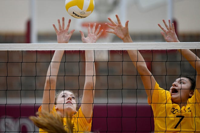 Henderson's Brooke Springer (2) and Kaylee Stott (7) defend the net as the Henderson County Lady Colonels play the Daviess County Panthers at Colonel Gym Tuesday, October  2, 2018.
