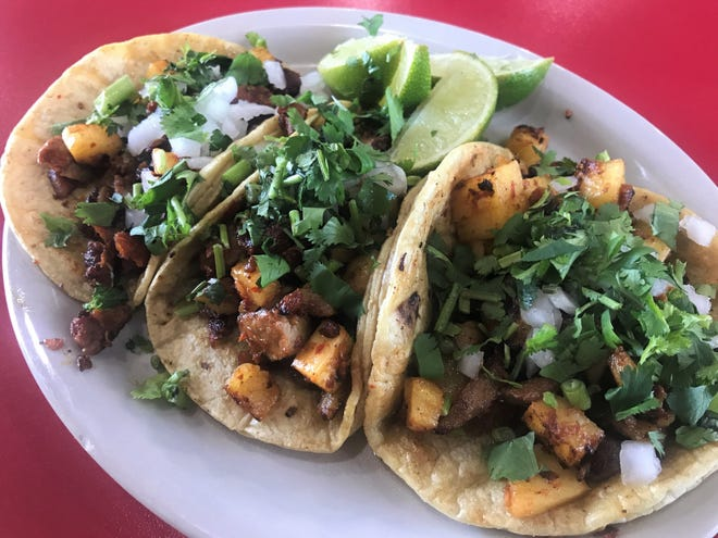 Al pastor tacos full of crispy spit-roasted pork and cubed pineapple in soft corn tortillas at Samano's in Noblesville.