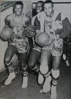 ATTUCKS27 109038 02/08/05 SAM RICHE / THE INDIANAPOLIS STAR:Oscar Robertson, Willie Merriweather and William Brown head for the opening game of the City Tournament in this photo from the 1955 yearbook. These are photos from the Crispus Attucks Museum in Indianapolis, IN from the state basetball championship team of 1955. These copy photos were taken on Tuesday, February 8, 2005.