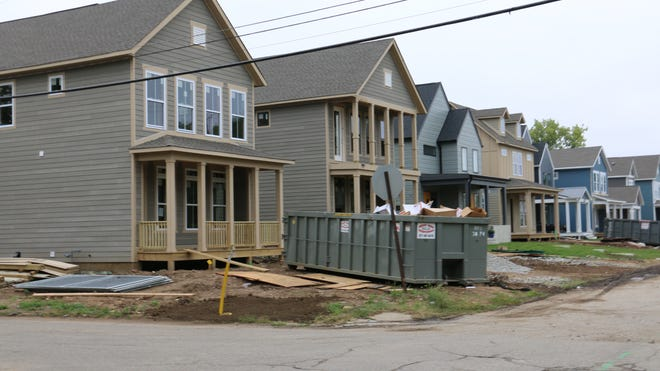 A row of houses is under construction on Alvord Street near the Monon Trail.