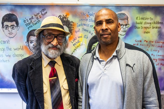 Hani Elkadi and Hamza Omar stand in front of a mural painted by Elkadi on Monday, Oct. 1, 2018, at Theodore Roosevelt Education Center in Iowa City. Omar is the juvenile courts liaison for the Iowa City Community School District and has worked in the district since 1997. Omar worked at South East Junior High from 1997 until 2013 an