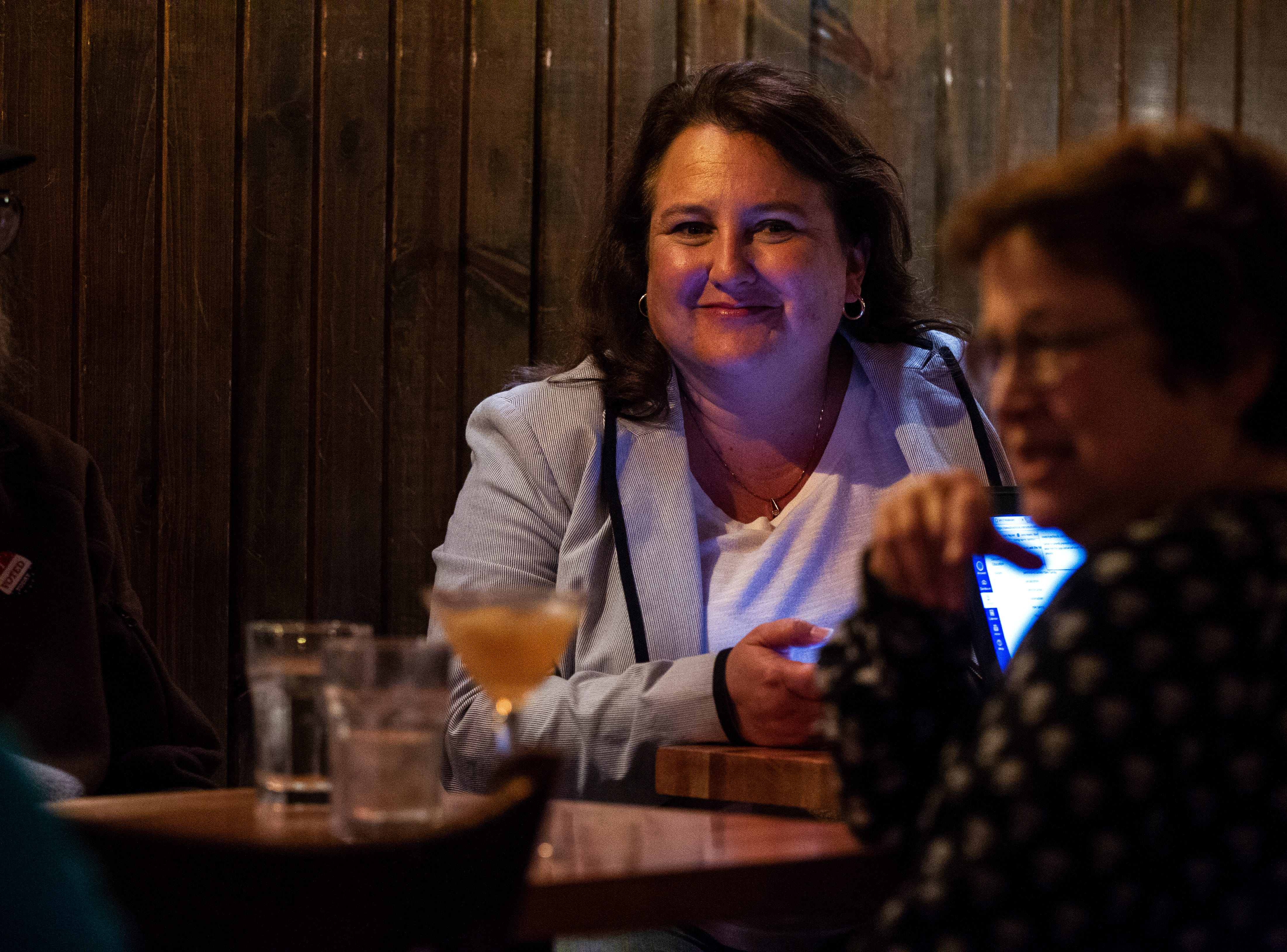 Ann Freerks talks with supporters while election results come in on Tuesday, Oct. 2, 2018, at Sanctuary Pub on Gilbert Street in Iowa City.