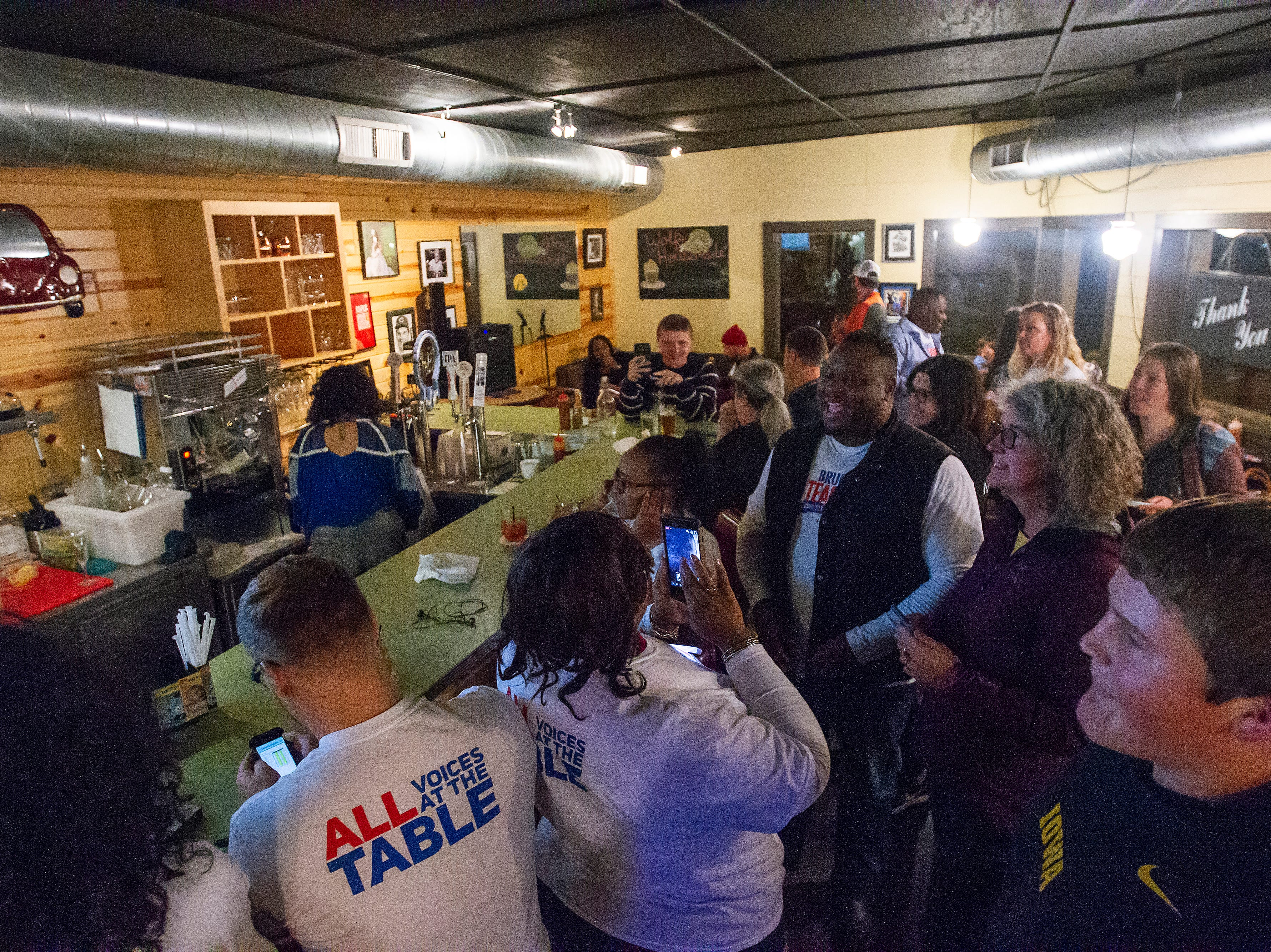 Bruce Teague celebrates with supporters after the final precinct reported its votes on Tuesday, Oct. 2, 2018, at Billy's High Hat Diner on Iowa Avenue in Iowa City.