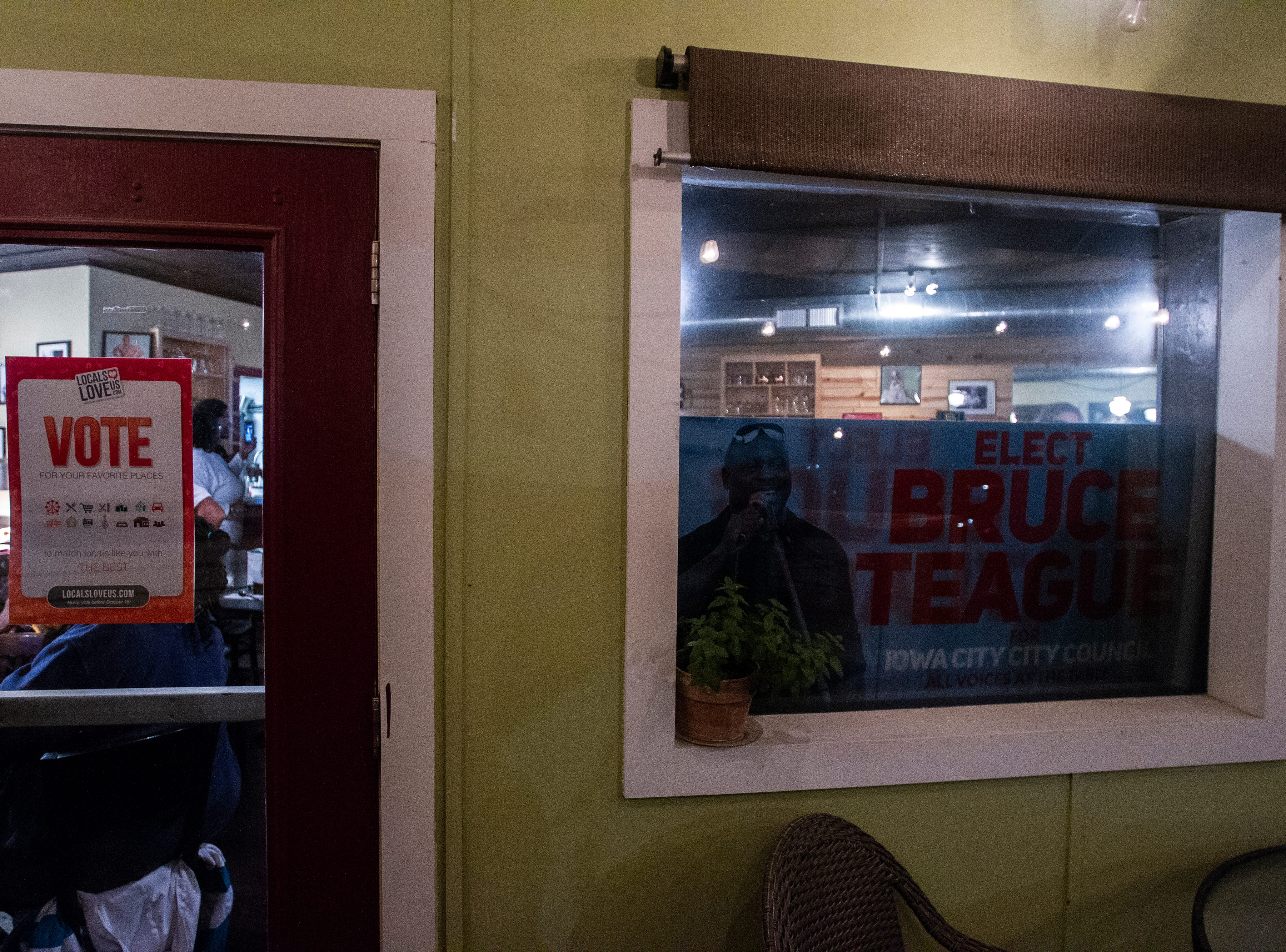 Bruce Teague posters line windows during a watch party with supporters on Tuesday, Oct. 2, 2018, at Billy's High Hat Diner on Iowa Avenue in Iowa City.