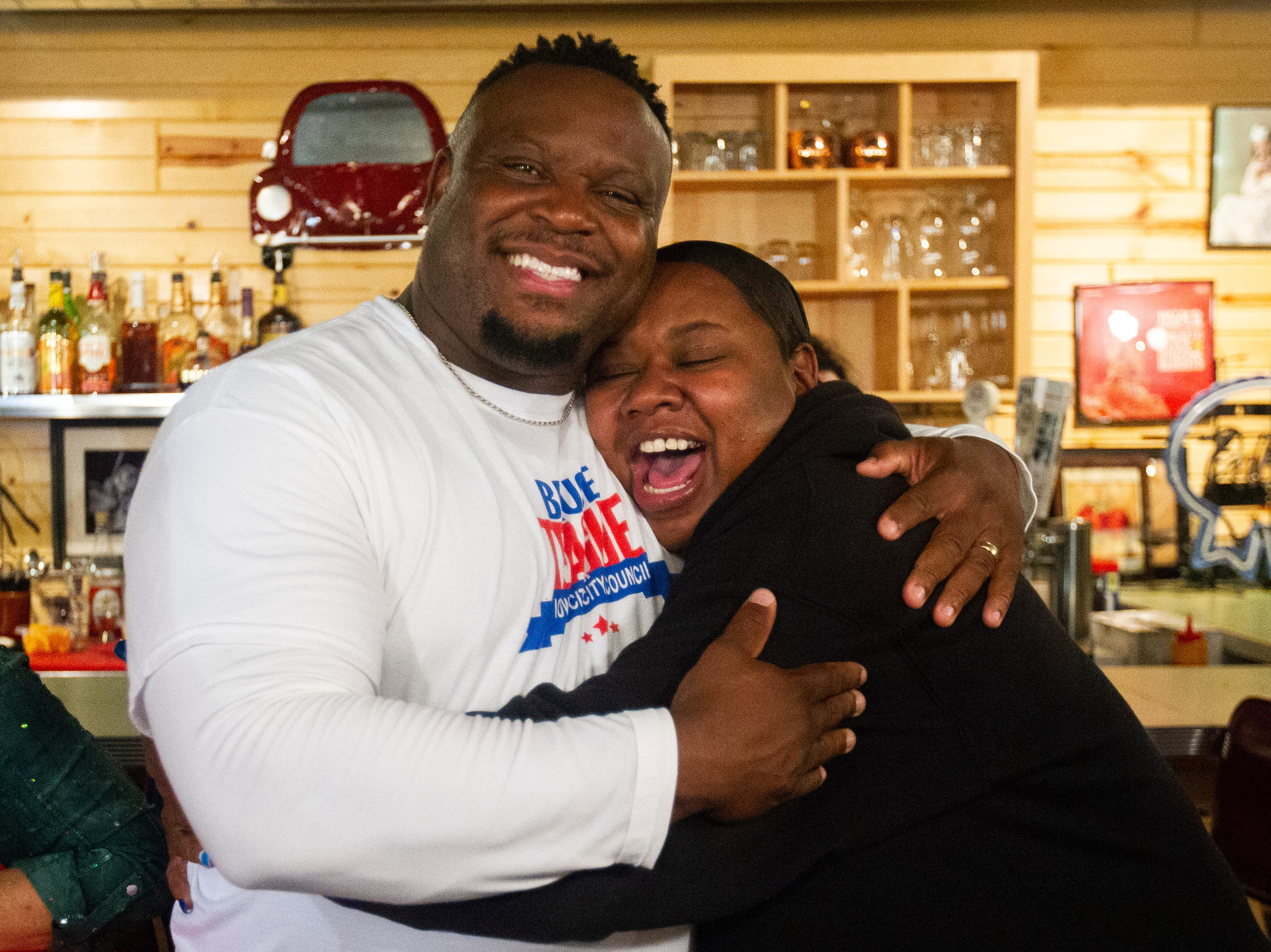 Bruce Teague embraces Royceann Porter on Tuesday, Oct. 2, 2018, at Billy's High Hat Diner on Iowa Avenue in Iowa City.