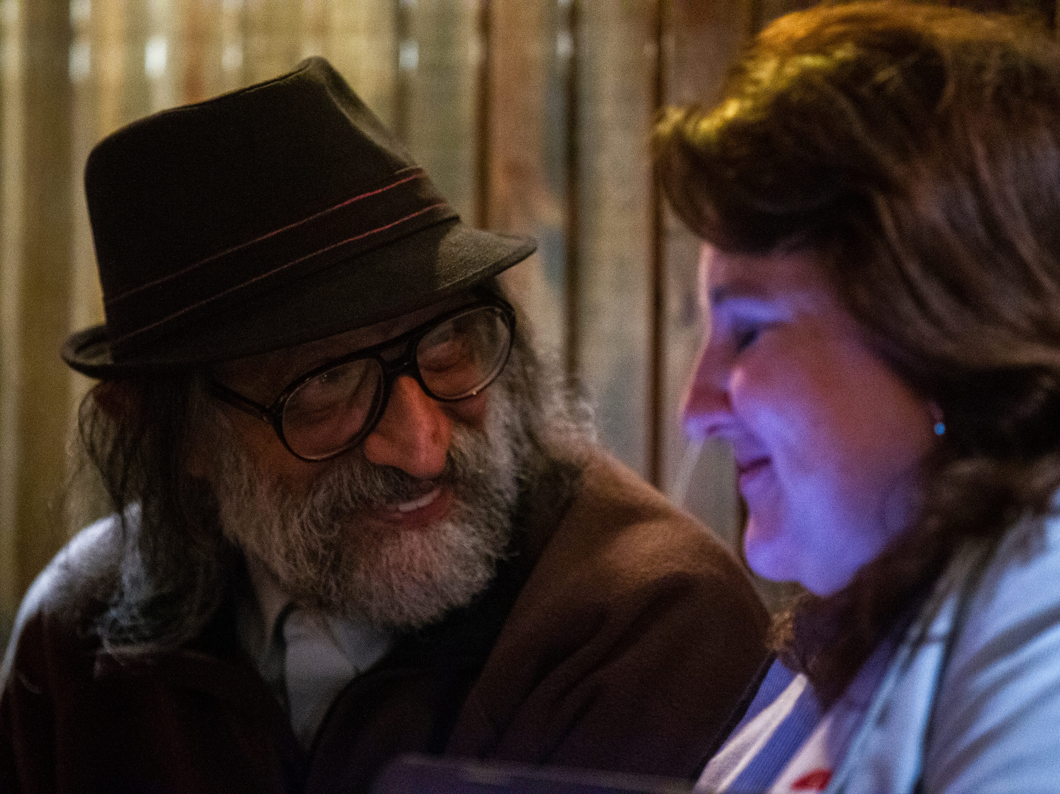 Hani Elkadi (left) talks with Ann Freerks while election results come in on Tuesday, Oct. 2, 2018, at Sanctuary Pub on Gilbert Street in Iowa City.