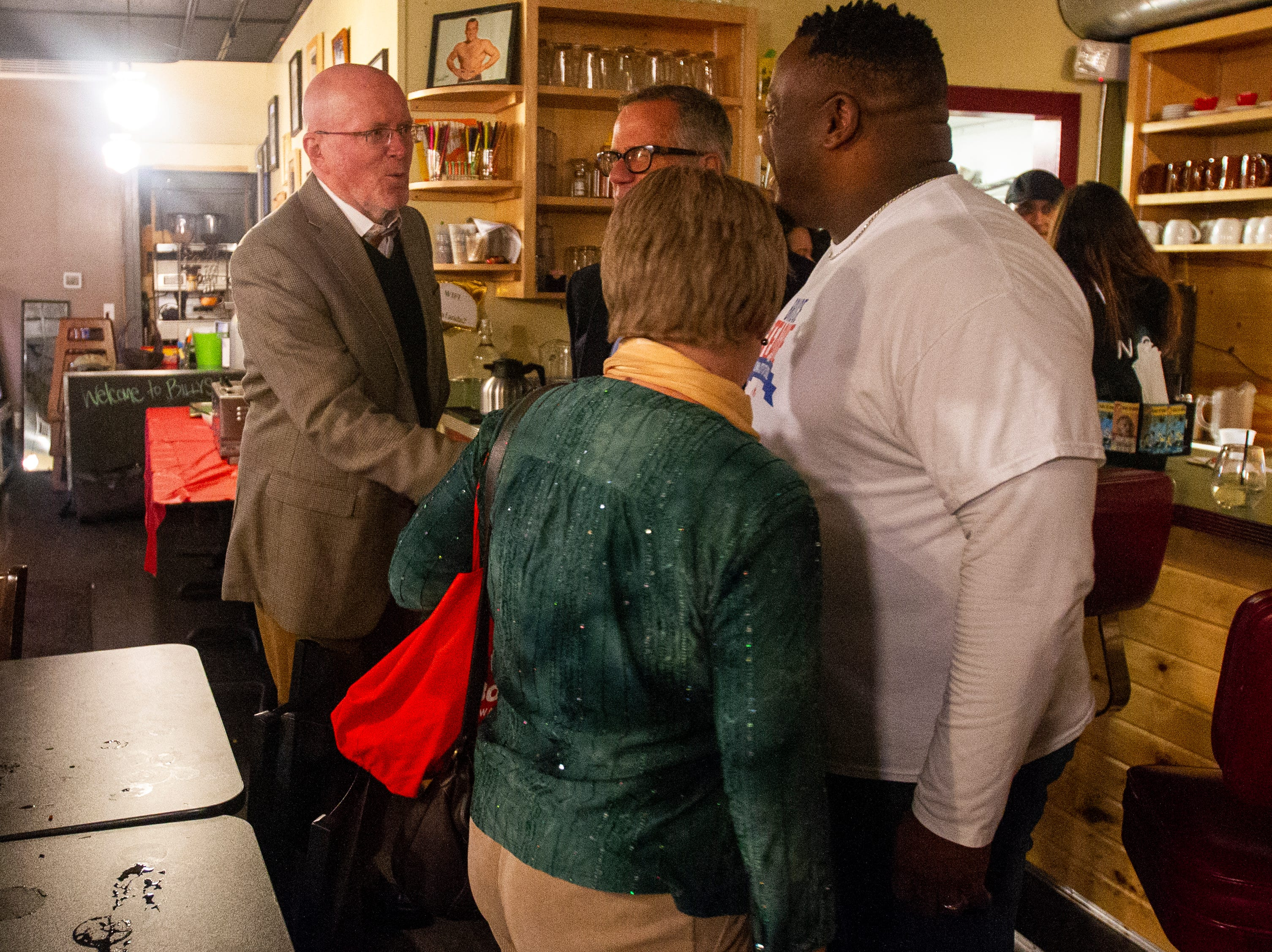 Iowa City Mayor Jim Throgmorton shakes hands with Bruce Teague on Tuesday, Oct. 2, 2018, at Billy's High Hat Diner on Iowa Avenue in Iowa City.