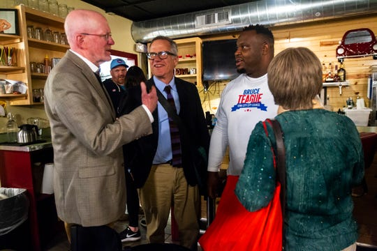 Iowa City Mayor Jim Throgmorton, John Thomas and Pauline Taylor congratulate Bruce Teague on Tuesday, Oct. 2, 2018, at Billy's High Hat Diner on Iowa Avenue in Iowa City.