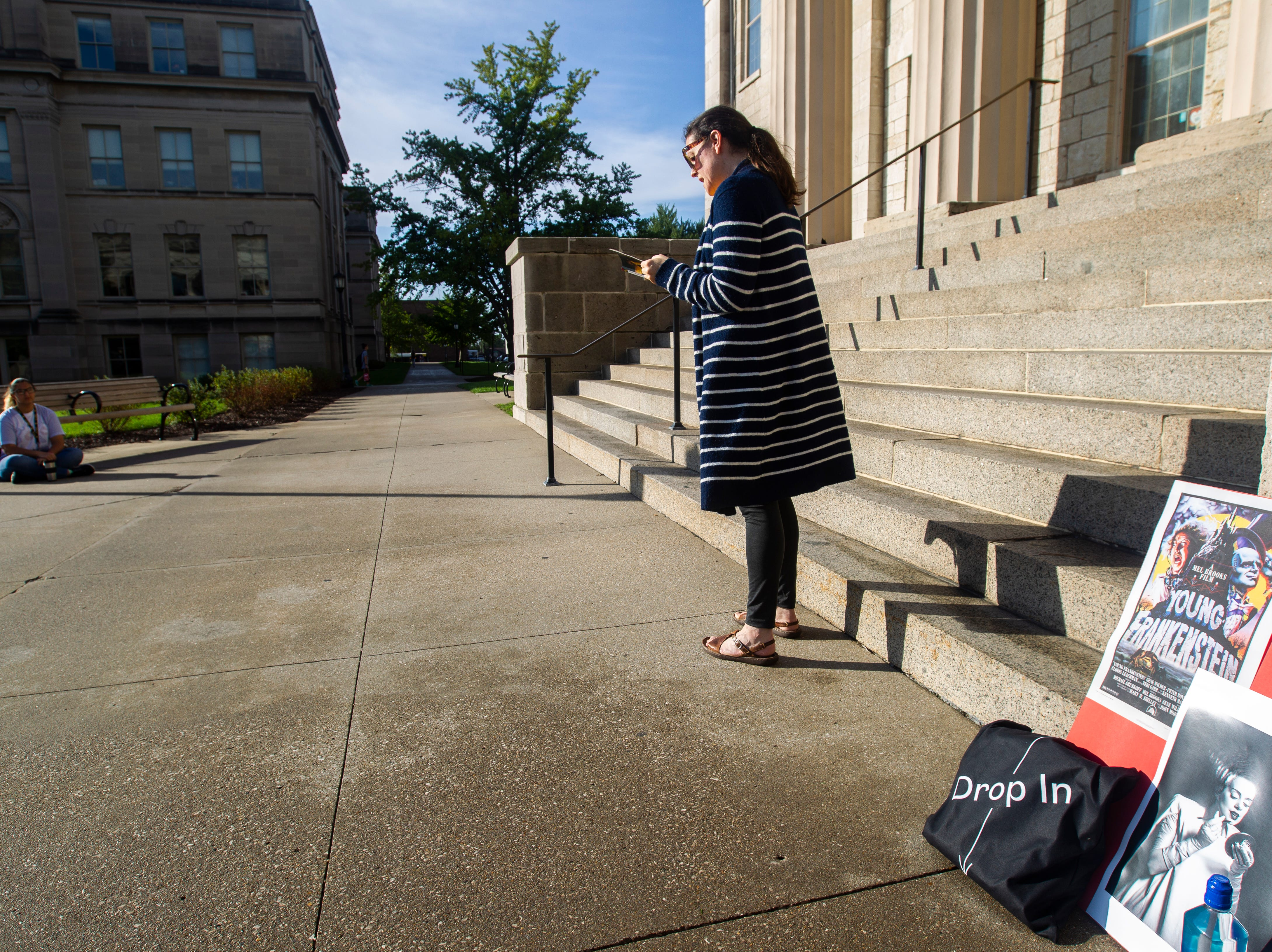 "Kathrine Moermond, education  and outreach Coordinator at the Old Capitol Museum, reads from ""Frankenstein"" by Mary Shelley on Wednesday, Oct. 3, 2018, on the east steps of the Old Capitol on the Pentacrest in Iowa City. Volunteers began reading the 1818 novel at 9 a.m. and planned on finishing by 6 p.m."