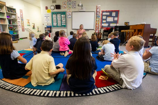 Whitney Giller leads a fourth grade class in a yoga exercise on Wednesday, Oct. 3, 2018, at Regina Elementary School in Iowa City. Giller is the kindergarten through 5th grade music teacher at Regina.