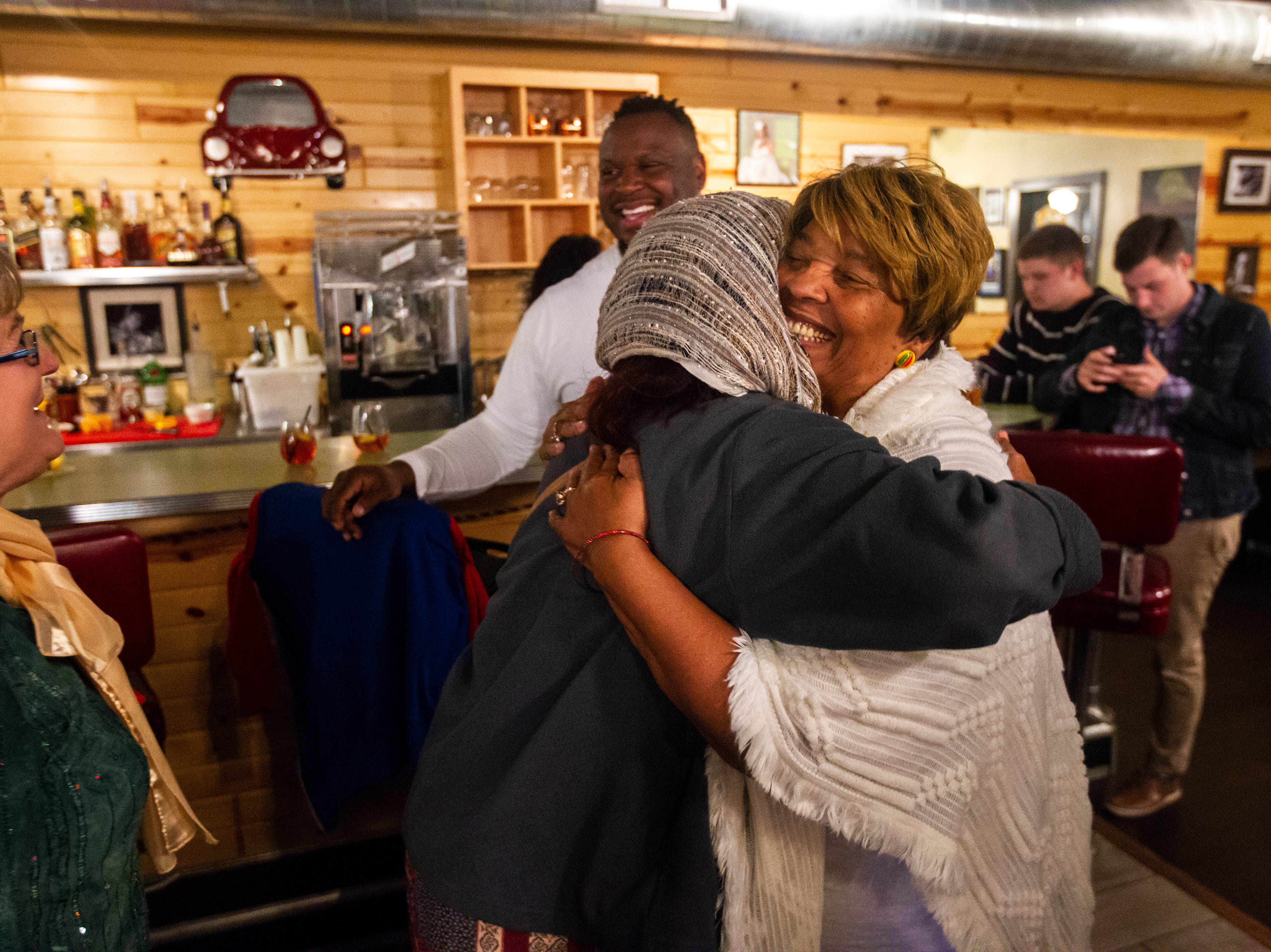 Mazahir Salih embraces Mary Teague, Bruce Teague's mother, on Tuesday, Oct. 2, 2018, at Billy's High Hat Diner on Iowa Avenue in Iowa City.