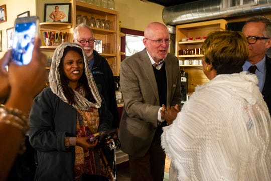 Iowa City Mayor Jim Throgmorton shakes hands with Mary Teague, Bruce Teague's mother, on Tuesday, Oct. 2, 2018, at Billy's High Hat Diner on Iowa Avenue in Iowa City.