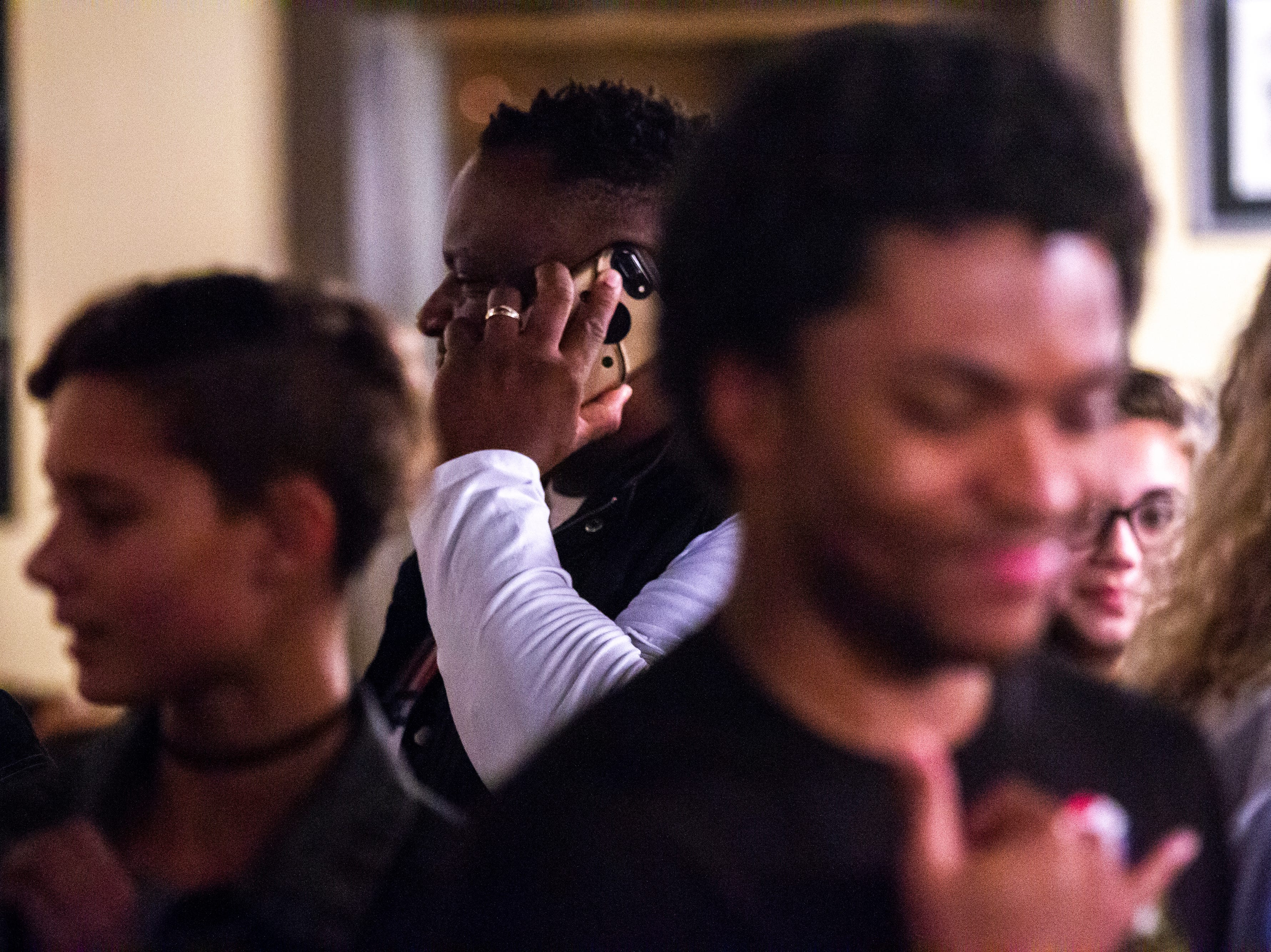 Bruce Teague takes a phone call while celebrating with supporters after the final precinct reported its votes on Tuesday, Oct. 2, 2018, at Billy's High Hat Diner on Iowa Avenue in Iowa City.