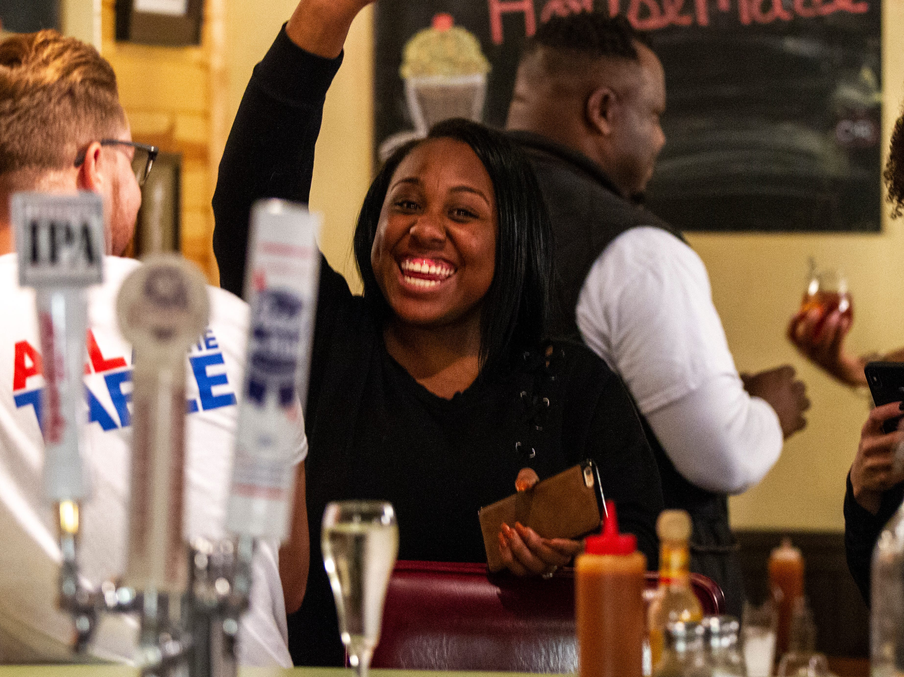 Emeral Green celebrates with Teague supporters after the final precinct reported its votes on Tuesday, Oct. 2, 2018, at Billy's High Hat Diner on Iowa Avenue in Iowa City.